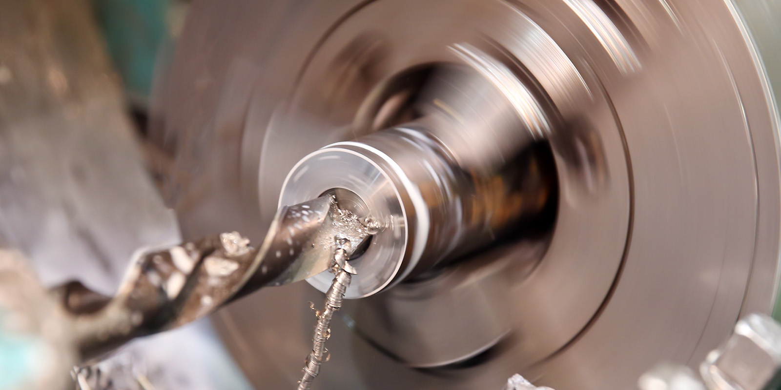Metalworking Industry: Workpiece Drilling On A Lathe Machine
